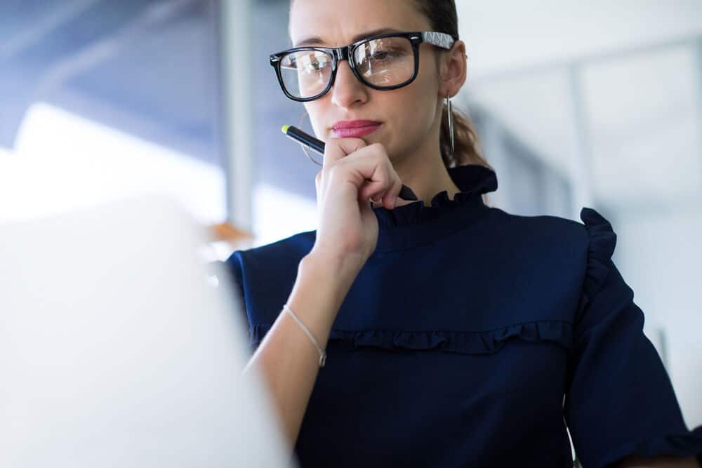 Female executive working over laptop at her desk in office